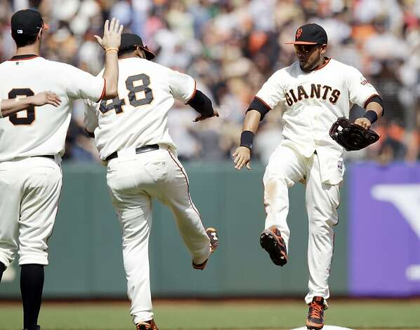 San Francisco Giants' Melky Cabrera, right, and Pablo Sandoval (48) celbrate after a win over the San Diego Padres in a baseball game in San Francisco,  Sunday, April 29, 2012. San Francisco won 4-1.  (AP Photo/Marcio Jose Sanchez) Photo: Marcio Jose Sanchez, Associated Press
