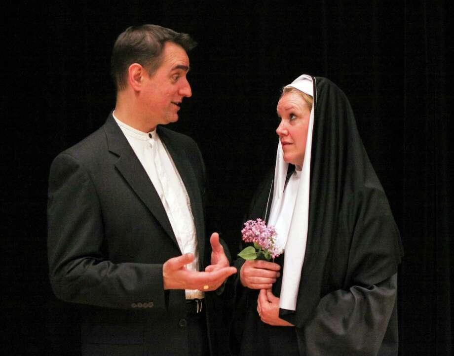 Richard Warren of Norwalk as Father Rivard and Kate Telfer of Greenwich as the ill-fated Sister Rita. Photo: Contributed Photo / Darien News
