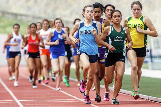 Johnson's Natalie Langan leads the pack during the Class 5A girls' 1,600-meter run in the Region IV-5A track and field meet Saturday at Alamo Stadium. Langan broke a 28-year-old 5A meet record in the 3,200 a day earlier by more than seven seconds with a time of 10:41.51, and won the 1,600 with a time of 5:904.64. Photo: Marvin Pfieffer / North Central News / Prime Time Newspapers 2012