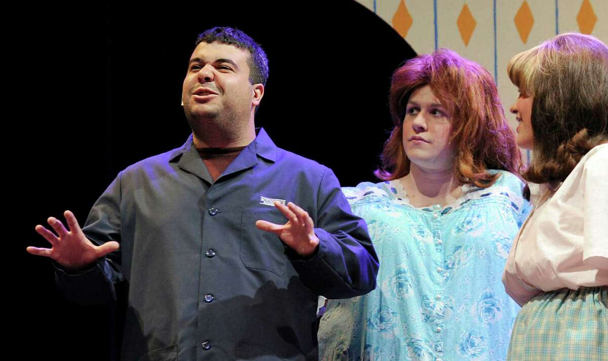 """Eddy Silva, left, a 2002 alumna of Danbury High School, Bennett Cognato and Sydney Coelho, play the Turnblad family in the school's production of the musical """"Hairspray"""", photographed during rehearsal Thursday, April 26, 2012."""