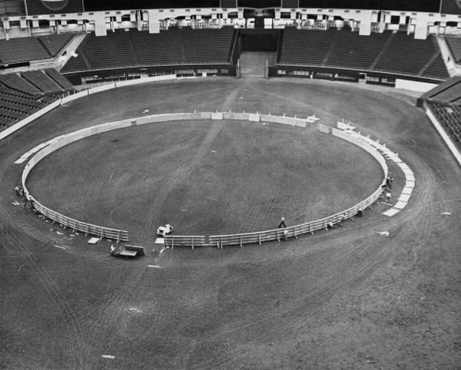 Installation of the bullring inside the Astrodome. The ring was 200 feet in diameter and was encircled by an outer fence so that if a bull jumped the first fence it will be caught between the two rings, February 1966. (Chronicle File)