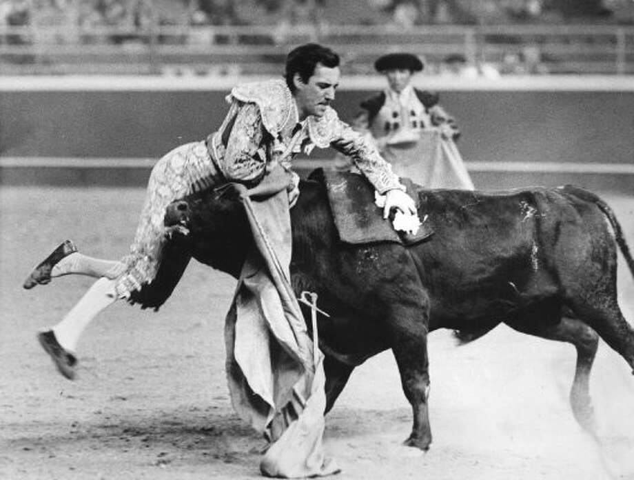 Matador Jaime Bravo gets tossed at the first Astrodome corrida, February 1966. (Darrell Davidson / Chronicle file)