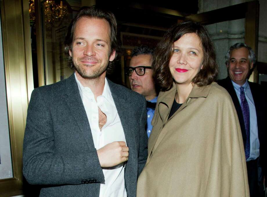 "FILE - In this March 15, 2012 file photo, actors Peter Sarsgaard amd Maggie Gyllenhaal  leave the opening night performance of the Broadway revival of Arthur Miller's ""Death of a Salesman"" in New York. Gyllenhaal's publicist said in an email Monday, April 30, 2012, that the actress gave birth to Gloria Ray on April 19 in New York. No more details were provided. The couple had their first daughter, Ramona, in 2006. They got married in 2009. (AP Photo/Charles Sykes, file) Photo: Charles Sykes"