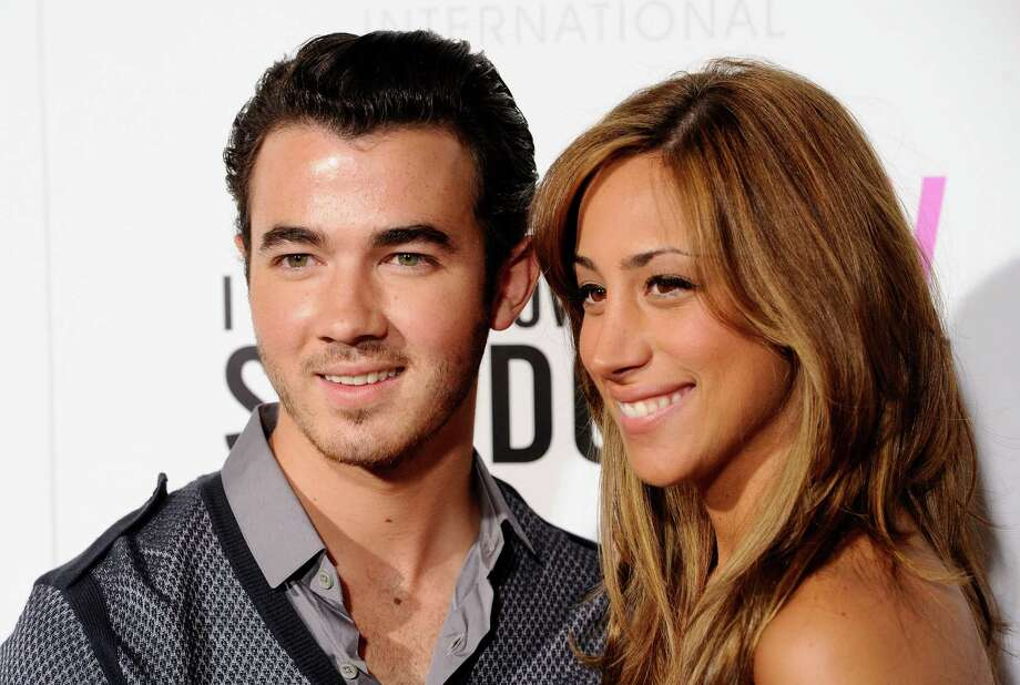 """FILE - In this Sept. 12, 2011 file photo, singer Kevin Jonas and his wife Danielle Deleasa attend the Cinema Society premiere of """"I Don't Know How She Does It"""", in New York.  The E! Entertainment network has expansion plans that include a new music series from """"American Idol"""" producer Nigel Lythgoe, a reality series with Kevin Jonas, the oldest member of the Jonas Brothers and his new bride and a talk show starring Whitney Cummings. (AP Photo/Peter Kramer, file) Photo: Peter Kramer"""