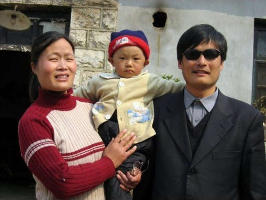 This undated photo provided by the China Aid Association shows blind Chinese legal activist Chen Guangchen, right, with his son, Chen Kerui, with his wife Yuan Weijing, left, in Shandong province, China. Chen, a well-known dissident who angered authorities in rural China by exposing forced abortions, made a surprise escape from house arrest on April 22, 2012, into what activists say is the protection of U.S. diplomats in Beijing, posing a delicate diplomatic crisis for both governments. Photo: AP
