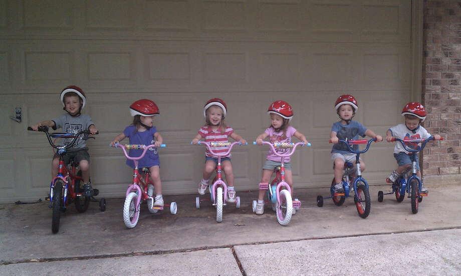 Mark Phillips and his siblings, quintuplets Kate, Becca, Ali, David, and John, on their bicycles. Photo: Xx