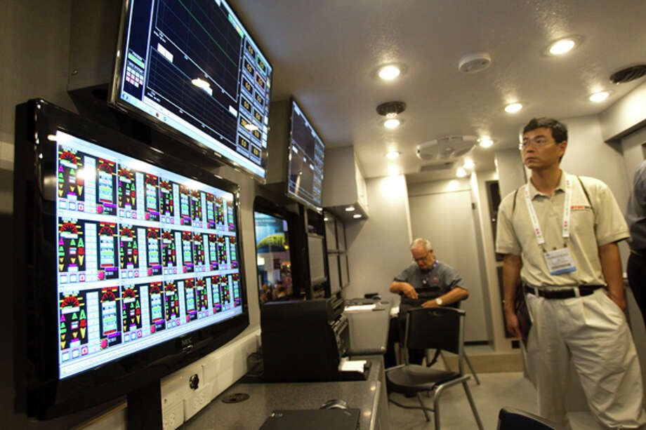 Dragon Energy control screens are put on display inside a truck during the 2012 Offshore Technology Conference Monday, April 30, 2012, in Houston. Photo: Brett Coomer, Houston Chronicle / © 2012 Houston Chronicle