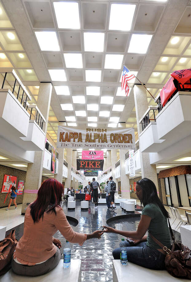 From left, Katril Roberson and Teraneka Horne sit at Lamar's Setzer Student Center in between classes on Tuesday.  Photo taken Tuesday, November 1, 2011. Guiseppe Barranco/The Enterprise