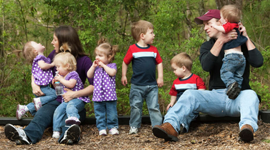Kelly and Bill Phillips try to pose their six children, five of whom are quintuplets, on March 27, 2010, in The Woodlands. Kelly said it is best to try and take a photo of them together early before they are all tired. The children are: from left, Ali, Becca, Kate, Mark, the two-year-old big brother, David and John. Photo: Brett Coomer, . / Houston Chronicle
