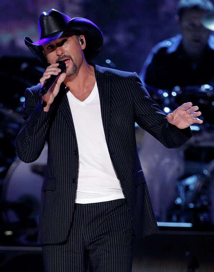 """FILE - In this April 19, 2010 file photo, Tim McGraw performs at the Brooks & Dunn """"The Last Rodeo"""" tribute concert in Las Vegas. Oh, the stories McGraw and Kenny Chesney could tell you from their early days together in Music City. And they're about to make more, joining forces on an ambitious stadiums-only tour next summer. (AP Photo/Matt Sayles, File) Photo: Matt Sayles / AP2010"""