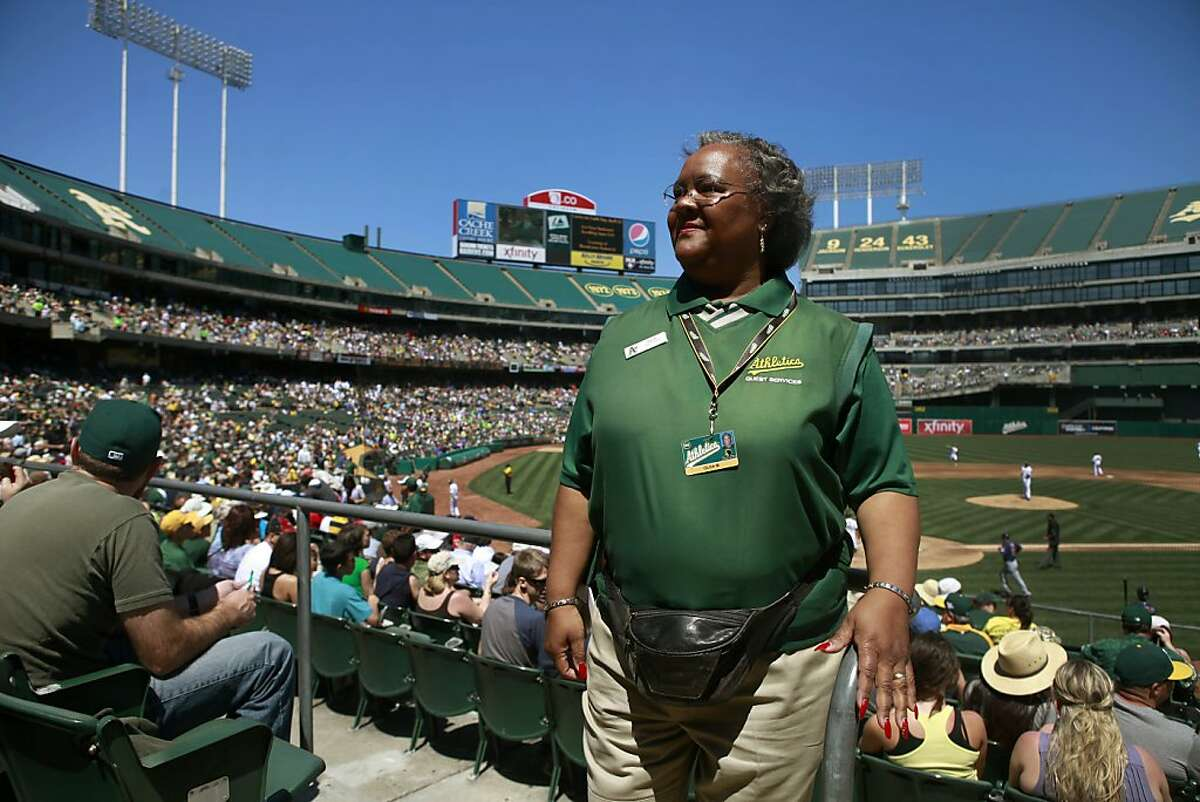 Olga Miranda-Smalls works as an usher for the Oakland Athletics on the weekends when she is not working her other job as an instructional aide at St. Bede Catholic School in Hayward.