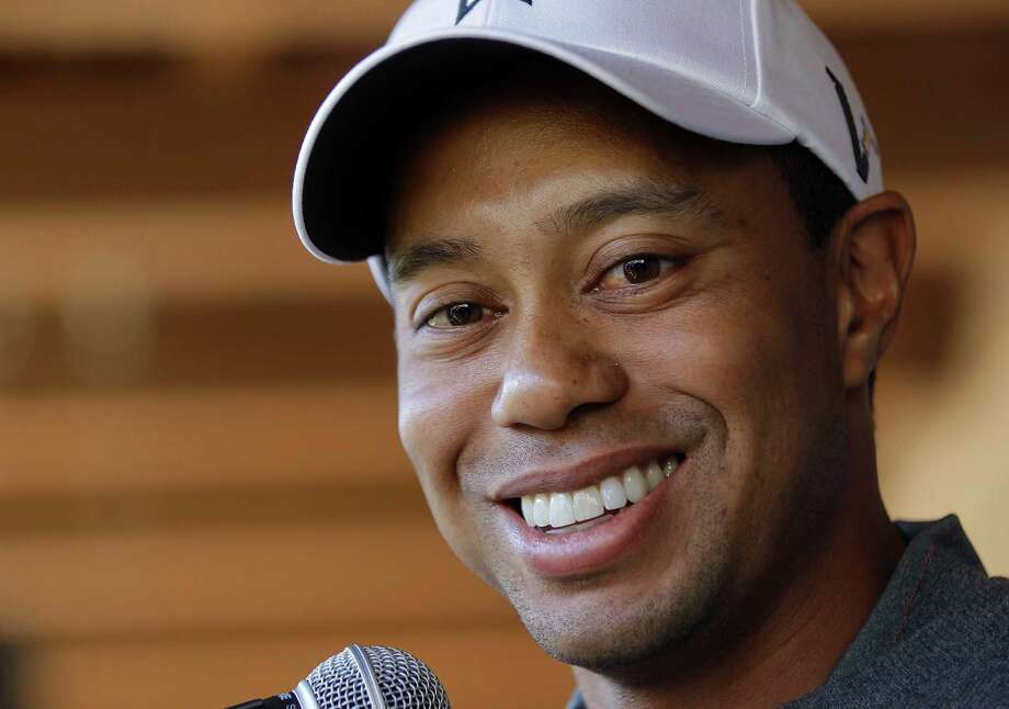 FILE - This Feb. 21, 2012 file photo shows Tiger Woods answering questions during a news conference before playing a practice round at the Match Play Championship golf tournament, in Marana, Ariz. Instead of a news conference before this week's Wells Fargo Championship, Woods answered 19 questions that were submitted through Facebook and Twitter.  (AP Photo/Julie Jacobson, File) Photo: Julie Jacobson