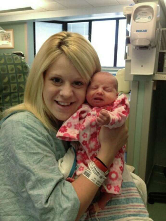 In this undated photo provided by the family, Aileen Dannelley holds her baby, Savannah, at Advocate Christ Medical Center in Oak Lawn, Ill. The one month old baby is being treated with methadone for withdrawal while she and her mother both fight addiction to powerful prescription painkillers. The number of U.S. babies born with signs of opiate drug withdrawal has tripled over a decade because of a surge in the use of illegal narcotics and powerful prescription painkillers among pregnant women, researchers say. (AP Photo/M. Spencer Green)