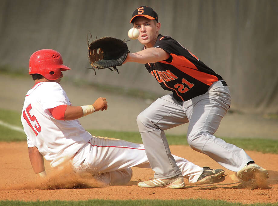 Fairfield Prep's Max Araya slides back safely into first base as Shelton's Ryan Daiss receives the throw in the second inning of their boys baseball matchup at Fairfield University on Monday, April 30, 2012. Photo: Brian A. Pounds / Connecticut Post