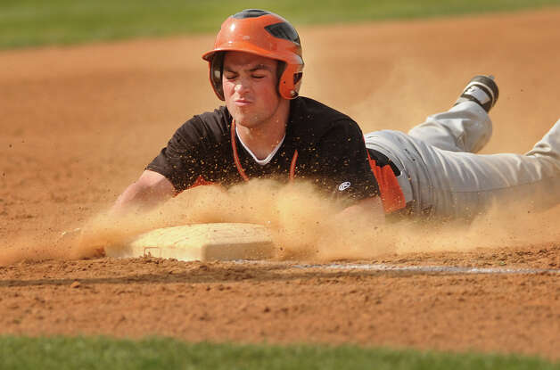 Shelton's Daniel McCormack slides safely into third base with a second inning triple in their boys baseball matchup with Fairfield Prep at Fairfield University on Monday, April 30, 2012. He would score later in the inning. Shelton won the game 5-0. Photo: Brian A. Pounds / Connecticut Post