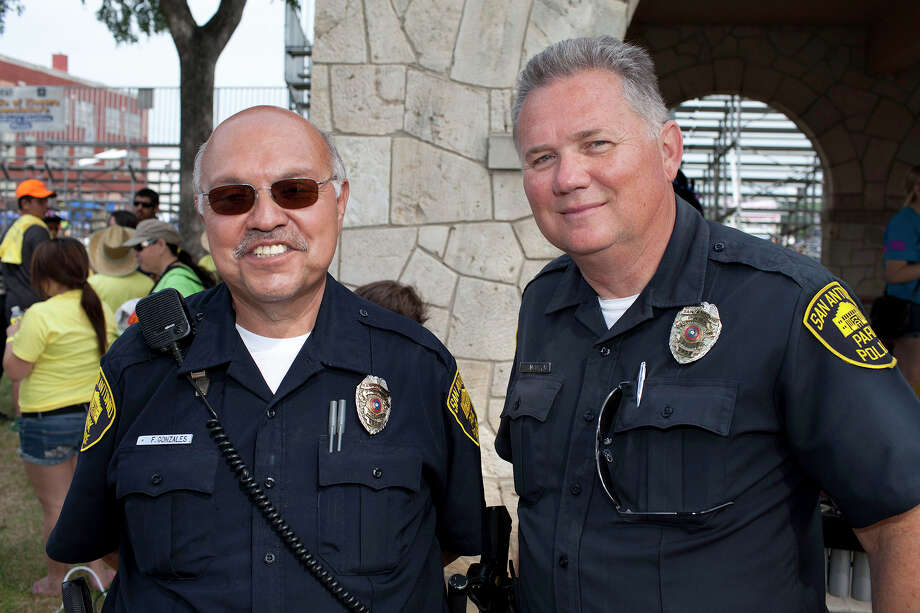 From the left, officers Frank Gonzales and Rubin Slaughter at the Battle of Flowers Parade at Maverick Park, Friday, April 27, 2012. Photo: J. Michael Short , FOR THE EXPRESS-NEWS / THE SAN ANTONIO EXPRESS-NEWS