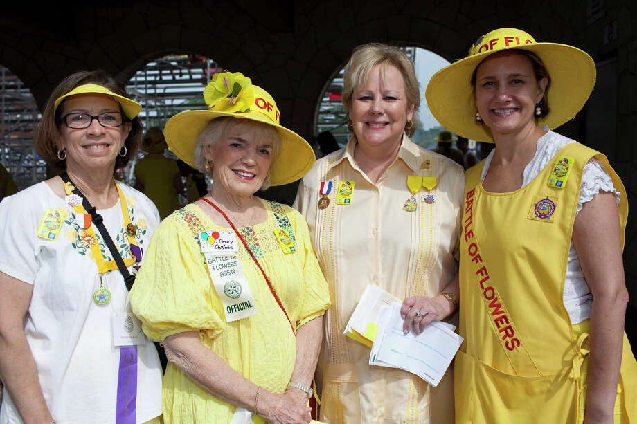From the left, Martha Ann Burch, Becky DeWees, Terrie Musselman and Anne Folkes at the Battle of Flowers Parade at Maverick Park, Friday, April 27, 2012. Photo: J. Michael Short , FOR THE EXPRESS-NEWS / THE SAN ANTONIO EXPRESS-NEWS