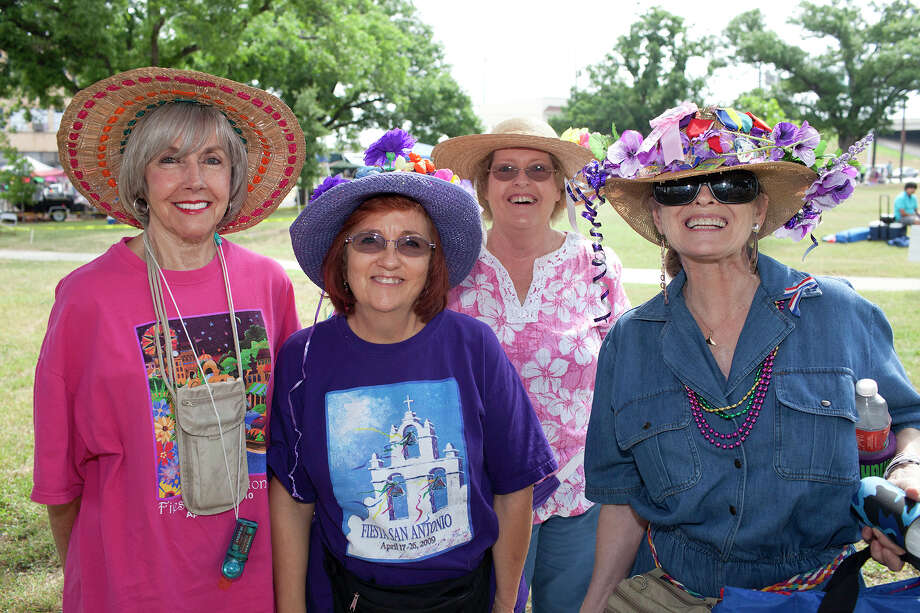 From the left, Ramona Hamilton, Dana Stewart, Carolyn Pearson and Diane Gange at the Battle of Flowers Parade at Maverick Park, Friday, April 27, 2012. Photo: J. Michael Short , FOR THE EXPRESS-NEWS / THE SAN ANTONIO EXPRESS-NEWS