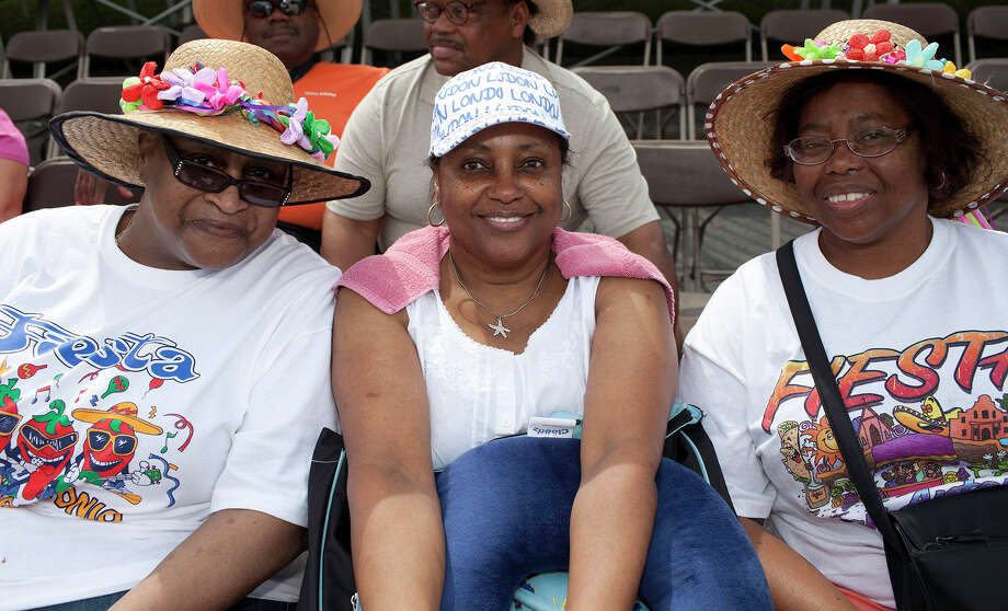 From the left, Lula Kirksey, Linda Jackson and Maggie Jones at the Battle of Flowers Parade at Maverick Park, Friday, April 27, 2012. Photo: J. Michael Short , FOR THE EXPRESS-NEWS / THE SAN ANTONIO EXPRESS-NEWS