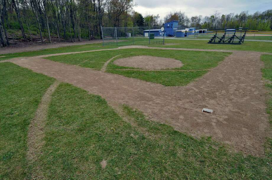 The remains of tire tracks are visible on  a recently vandalized baseball diamond that has been repaired, at the Twin Town Little League complex on Monday April 30, 2012 in Poestenkill, NY.  (Philip Kamrass / Times Union ) Photo: Philip Kamrass / 00017491A