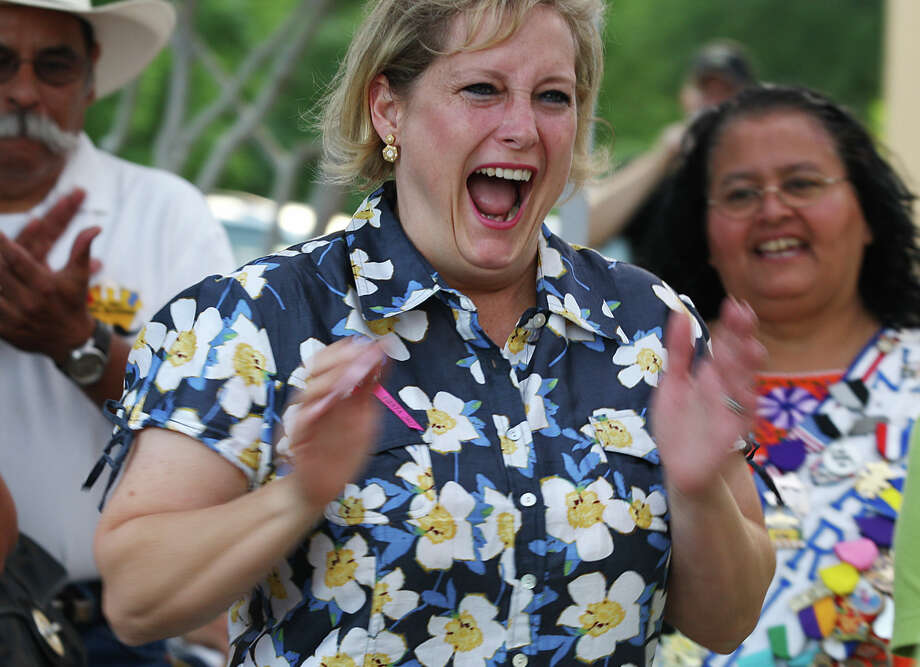 Anna-Laura Block, reacts as she is declared the winner of the Monday's Pounds of Pins at the Fiesta Store on Broadway, April 30, 2012. The contestant with the heaviest load of Fiesta pins won a $250 Macy's gift card. They also got to designate a Fiesta nonprofit member for a $250 donation. Prizes were also given for second and third place. Blocks entry weight in at 12.40 lbs. and took first place. Photo: JERRY LARA, San Antonio Express-News / © 2012 San Antonio Express-News