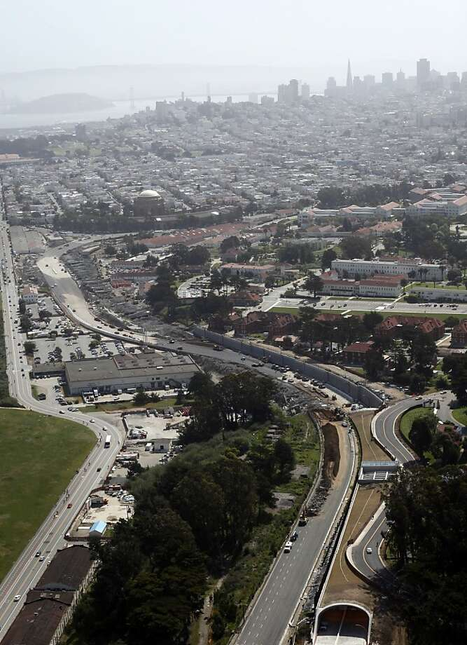 Crews work to demolish Doyle Drive, the narrow approach to the Golden Gate Bridge, in San Francisco, Calif., Sunday, April 29, 2012.  The 1.6-mile approach, which opened along with the Golden Gate Bridge in 1937, closed for good at 8 p.m. Friday between Marina Boulevard/Richardson Avenue and Highway 1.  Crews spent the weekend demolishing Doyle Drive, which will be replaced by the $1.1 billion Presidio Parkway project.  At bottom right is the southbound tunnel, which will be used by both directions of traffic until the northbound tunnel is complete. Photo: Sarah Rice, Special To The Chronicle