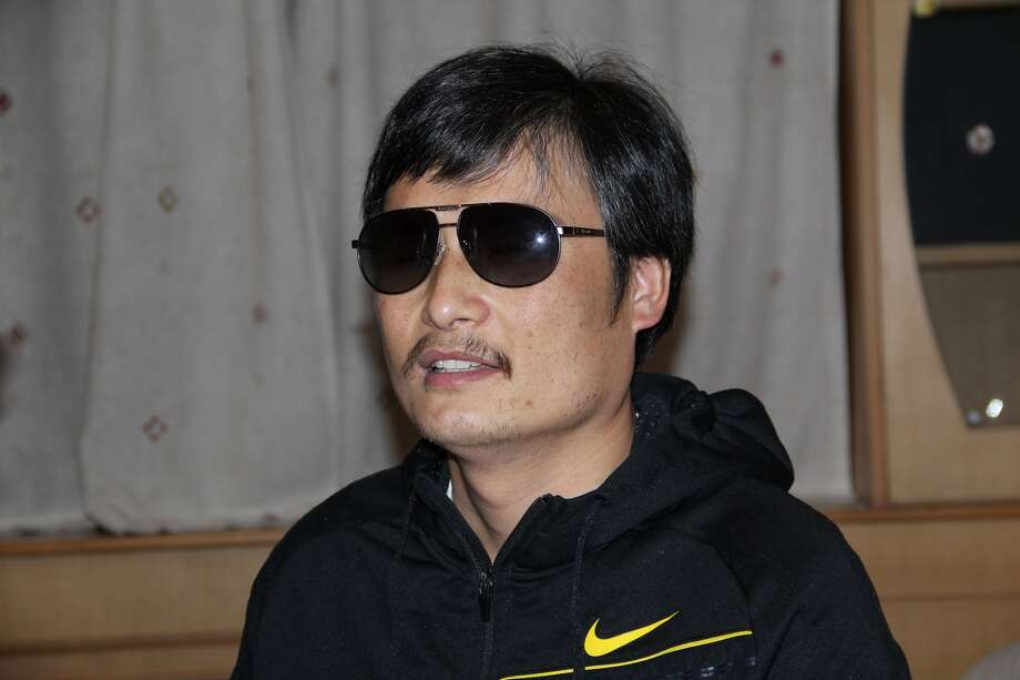 In this photo taken in late April, 2012, and released by Zeng Jinyan, blind Chinese legal activist Chen Guangcheng is seen at an undisclosed location in Beijing during a meeting with human rights activists Hu Jia and Zeng Jinyan. Chen, an inspirational figure in China's rights movement, slipped away from his well-guarded rural village on April 22, 2012, and made it to a secret location in Beijing on Friday, April 27. Activists say Chen is under the protection of U.S. diplomats in Beijing. (AP Photo/Zeng Jinyan) Photo: Zeng Jinyan