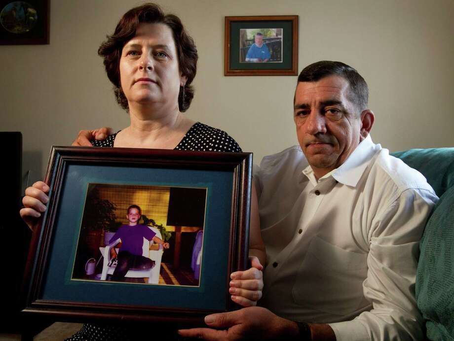Colleen and Bobby Middleton's son Robbie was horribly burned when he was 8. Prosecutors now want to pursue the case. Photo: Brett Coomer / © 2012 Houston Chronicle
