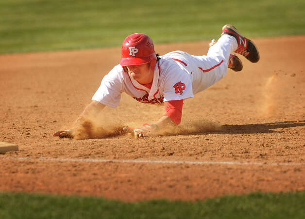 Fairfield Prep's Ryan Wright dives head first into third base with triple in the third inning of their boys baseball matchup with Shelton at Fairfield University on Monday, April 30, 2012. Shelton won the game 5-0. Photo: Brian A. Pounds / Connecticut Post