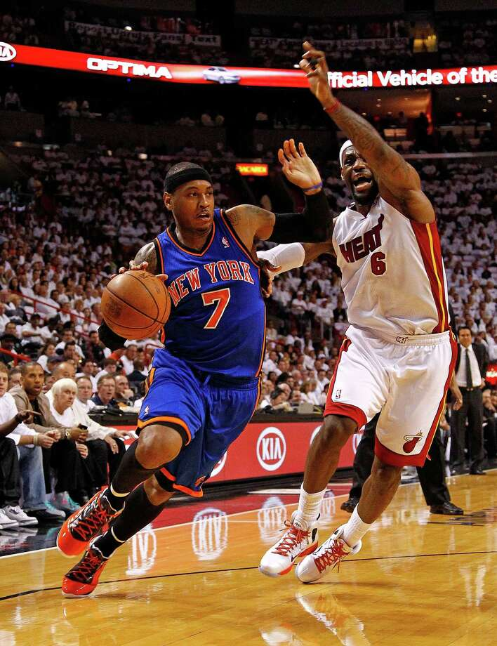 Carmelo Anthony of the Knicks drives on Miami's LeBron James during Monday's playoff game. Photo: Mike Ehrmann, Mike Ehrmann/Getty Images / 2012 Getty Images