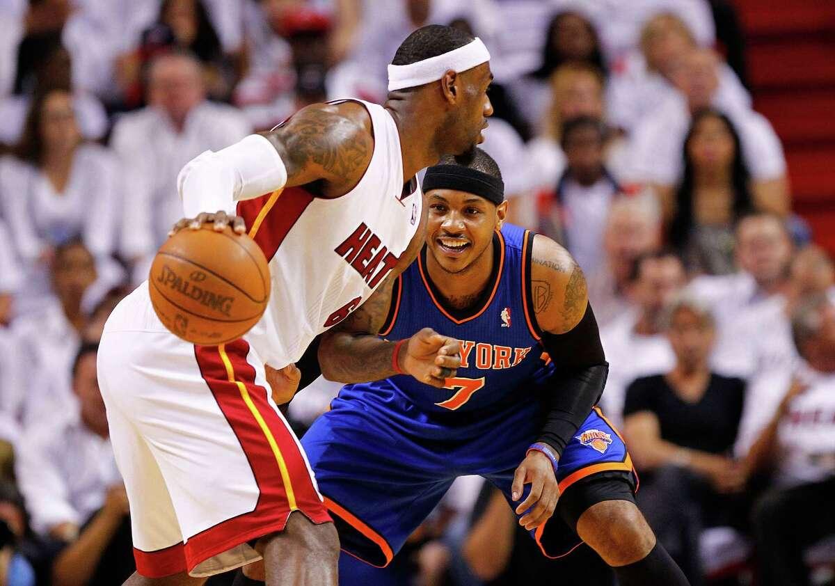 Miami's LeBron James is defended by Carmelo Anthony of the Knicks during Monday's playoff game.