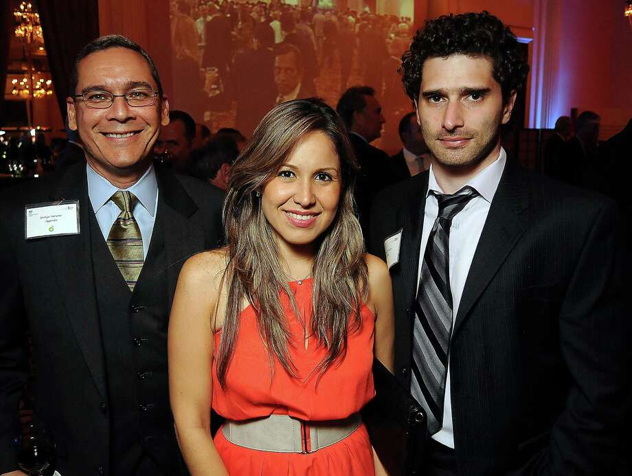 From left: George Soriano, Sara Catsulis and Emiliano Pelegri at the UK Energy Excellence reception at the Hilton Post Oak Hotel Monday, April 30, 2012. (Dave Rossman Photo) Photo: Dave Rossman, For The Chronicle / © 2012 Dave Rossman