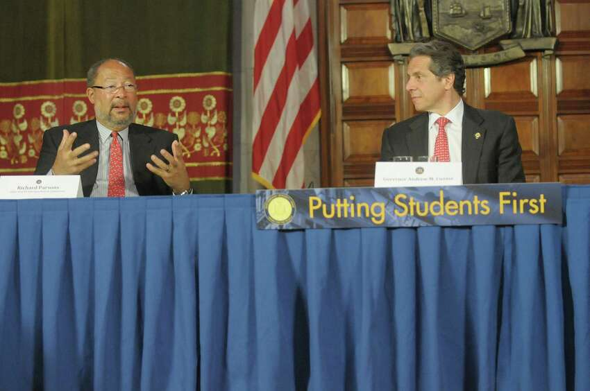 Richard Parsons, left, chair of the New NY Education Reform Commission, addresses those gathered as Governor Andrew Cuomo looks on during the initial meeting of the commission at the capitol on Monday, April 30, 2012 in Albany, NY. (Paul Buckowski / Times Union)