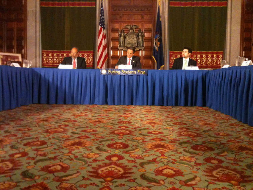 Gov. Andrew Cuomo, center, held a press conference to announces a new education commission in the Red Room at the capitol, Monday, April 30, 2012 in Albany, N.Y. (Paul Buckowski / Times Union)
