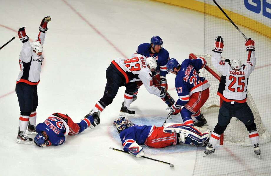 Washington Capitals Jason Chimera (25) reacts after scoring a goal in the first period of Game 2 of the second round of the NHL playoffs at Madison Square Garden in New York, on April 30, 2012. The Capitals won 3-2. (Jason Szenes/The New York Times) Photo: JASON SZENES / NYTNS