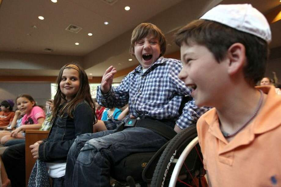 Next to his cousin, Misha Berry, 9, Aaron Berry, 9, shares a laugh with one of his best friends, Jack Greenberg at Beth Yeshurun Day School during a school assembly Thursday, April 5, 2012, in Houston. (Johnny Hanson / Houston Chronicle)