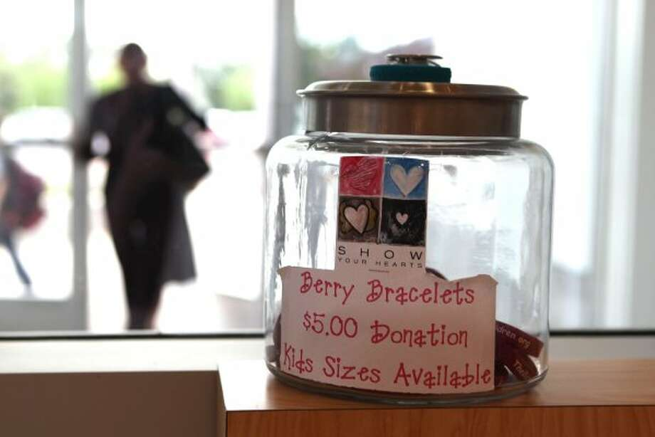 A jar of Berry Bracelets sits in the entry way to the Beth Yeshurun Day School where they are trying to raise money for the family. (Johnny Hanson / Houston Chronicle)