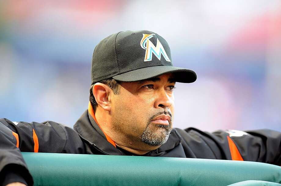WASHINGTON, DC - APRIL 20:  Manager Ozzie Guillen #13 of the Miami Marlins watches the game against the Washington Nationals at Nationals Park on April 20, 2012 in Washington, DC.  (Photo by Greg Fiume/Getty Images) Photo: Greg Fiume, Getty Images