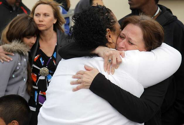 Cathy Vanpool, right, hugs Solialofi Ieremia, the aunt and legal guardian of Osana Futi during a memorial for the teen. Friends and family of Osana Futi gathered at Newark Memorial High School in Newark, Calif.,  on Monday, April 30, 2012, to pay tribute to the teen who was killed on Saturday night. Photo: Carlos Avila Gonzalez, The Chronicle