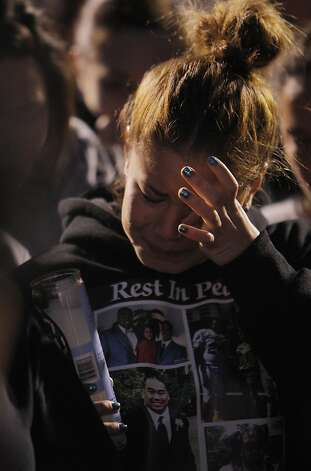 Kayla Tate, a cousin of Osana Futi, cries during a candlelight vigil for the teen on Monday. Friends and family of Osana Futi gathered at Newark Memorial High School in Newark, Calif.,  on Monday, April 30, 2012, to pay tribute to the teen who was killed on Saturday night. Photo: Carlos Avila Gonzalez, The Chronicle