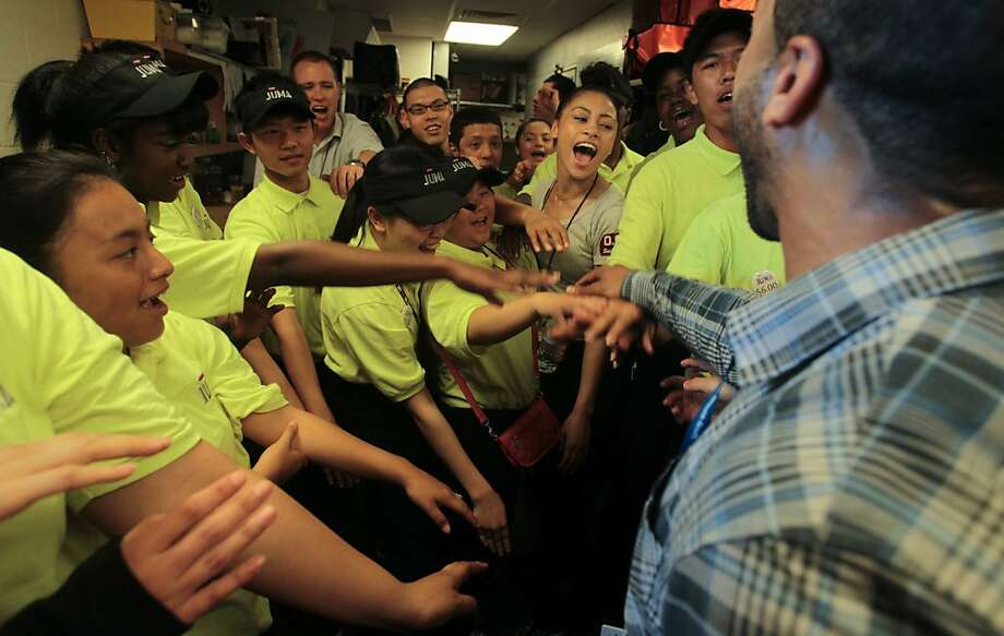 Enterprise Manager Joshua Smith, right, rallies his Juma sales staff before a Giants game at AT&T Park on Sunday, April 29, 2012, in San Francisco. Juma is a non-profit thats gives teens work experience. Photo: Mathew Sumner, Special To The Chronicle