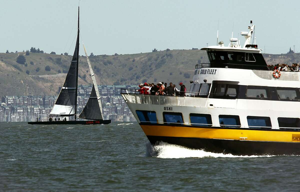 Racing yacht, USA 76 cruises near the Blue and Gold's