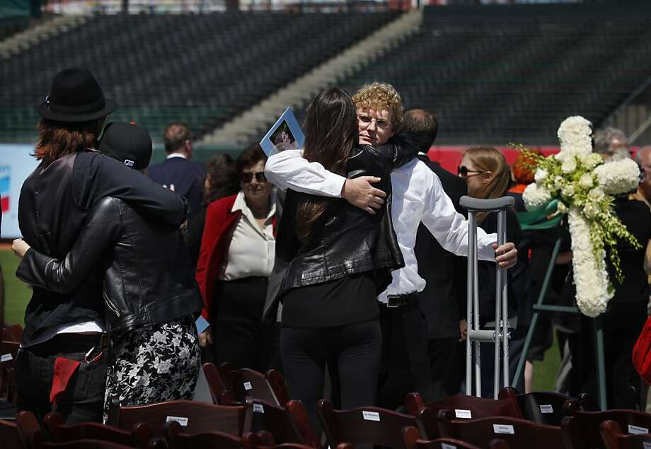 Nick Vos (right), boyfriend of Alexis Busch, receives a hug from a mourner after a public memorial service for Alexis Busch, one of the victims of a deadly yacht crash near the Farallon Islands, at AT & T Park on Monday, April 30, 2012 in San Francisco, Calif. Photo: Lea Suzuki, The Chronicle