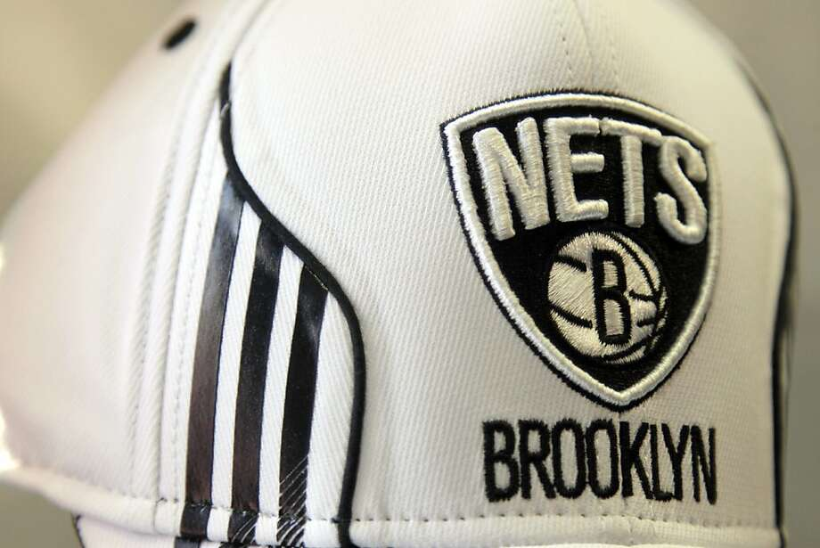 A hat bearing the new logo of the Brooklyn Nets is displayed during a news conference to unveil the new logos of the Brooklyn Nets in New York, Monday, April 30, 2012.  The Nets will be moving from New Jersey to the new Barclays Center in Brooklyn, New York for the 2012-2013 NBA basketball season. (AP Photo/Seth Wenig) Photo: Seth Wenig, Associated Press