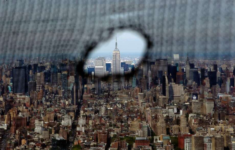 NEW YORK, NY - APRIL 30:  A torn safety net provides a window view from One World Trade Center of the Empire State Building (C), and the Manhattan skyline, on April 30, 2012 in New York City.  One World Trade Center is being built to replace the twin towers destroyed in the Sept. 11 attacks. It reached just over 1,250 feet on Monday. That's just taller than the observation deck on the Empire State Building. (Photo by Lucas Jackson-Pool/Getty Images) *** BESTPIX *** Photo: Pool, Getty Images