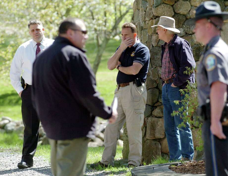 In this file photo, Connecticut Major Crime Squad and state detectives assist Newtown police with an investigation into the remains of Elizabeth Heath, whose husband, John, is accused of murdering her in 1984. The cold case murder trial is expected to begin Thursday, Sept. 26, 2013.  Photo: Chris Ware, ST / The News-Times