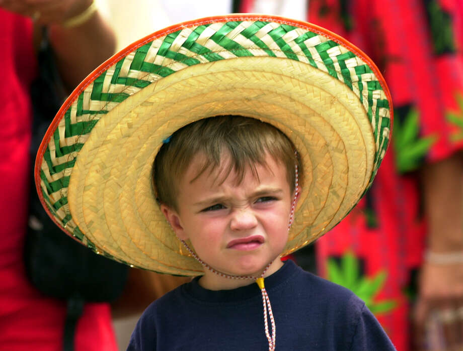 Bas Hollingsworth, 3, takes in the sights during the Cinco de Mayo celebtations at Market Square Saturday May 4, 2002. Photo: EDWARD A. ORNELAS, EN / EN