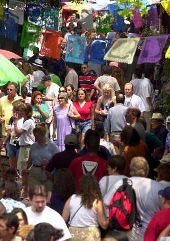Crowds make their way through Market Square Saturday May 4, 2002 during the Cinco de Mayo celebtation. Photo: EDWARD A. ORNELAS, EN / EN