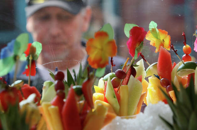 Fernando Madrid, from Arizona, looks over the fruit cup at Market Square on Sunday, May 4, 2008. A weekend celebration iof Cinco de Mayo came to an end on Sunday. The event featured food, music and drinks. Photo: JERRY LARA, SAN ANTONIO EXPRESS-NEWS / glara@express-news.net