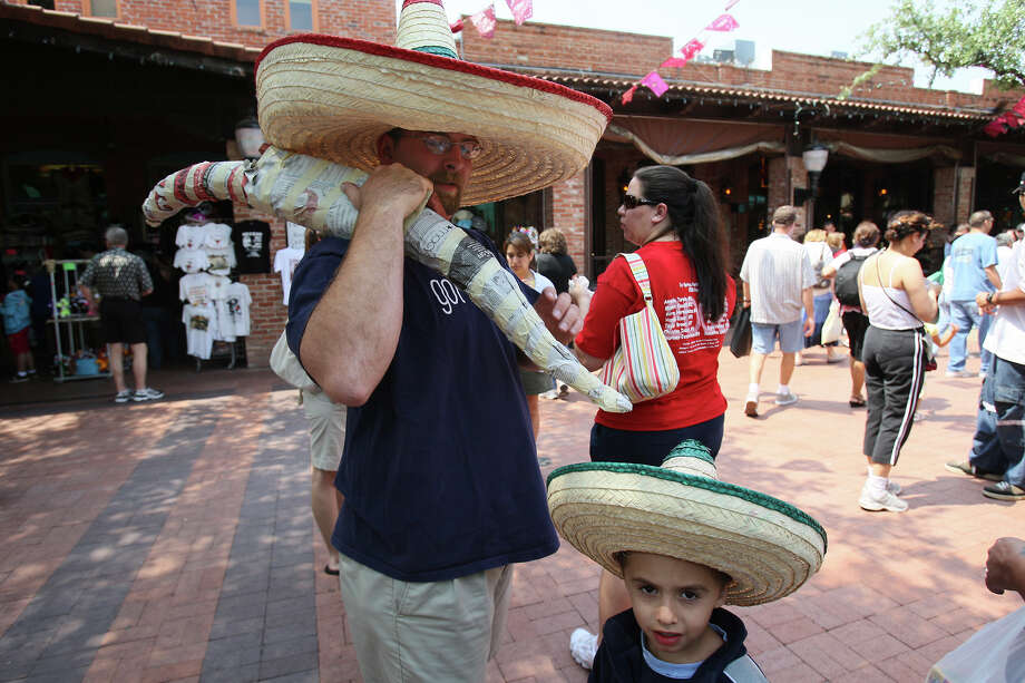 With matching hats, Garrett James and his son, Christian, 5, from Bastrop, shop at Market Square during a celebration of Cinco de Mayo on Sunday, May 4, 2008. Photo: HELEN L. MONTOYA, SAN ANTONIO EXPRESS-NEWS / glara@express-news.net